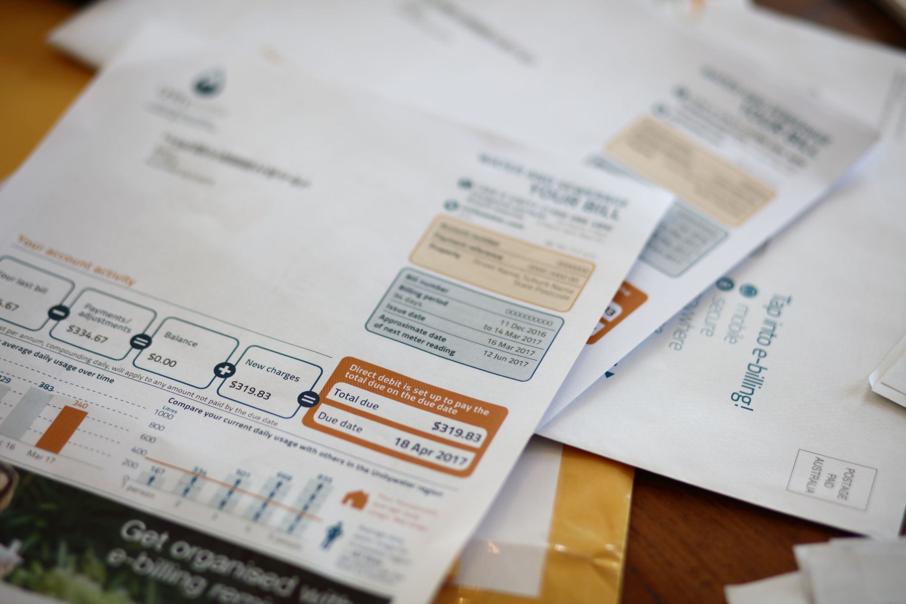 Unitywater bills lying on desk in pile of papers