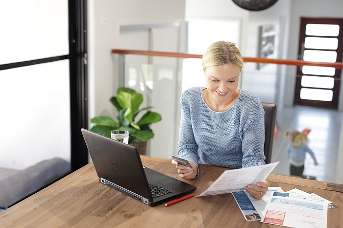 Woman setting up direct debit on laptop computer
