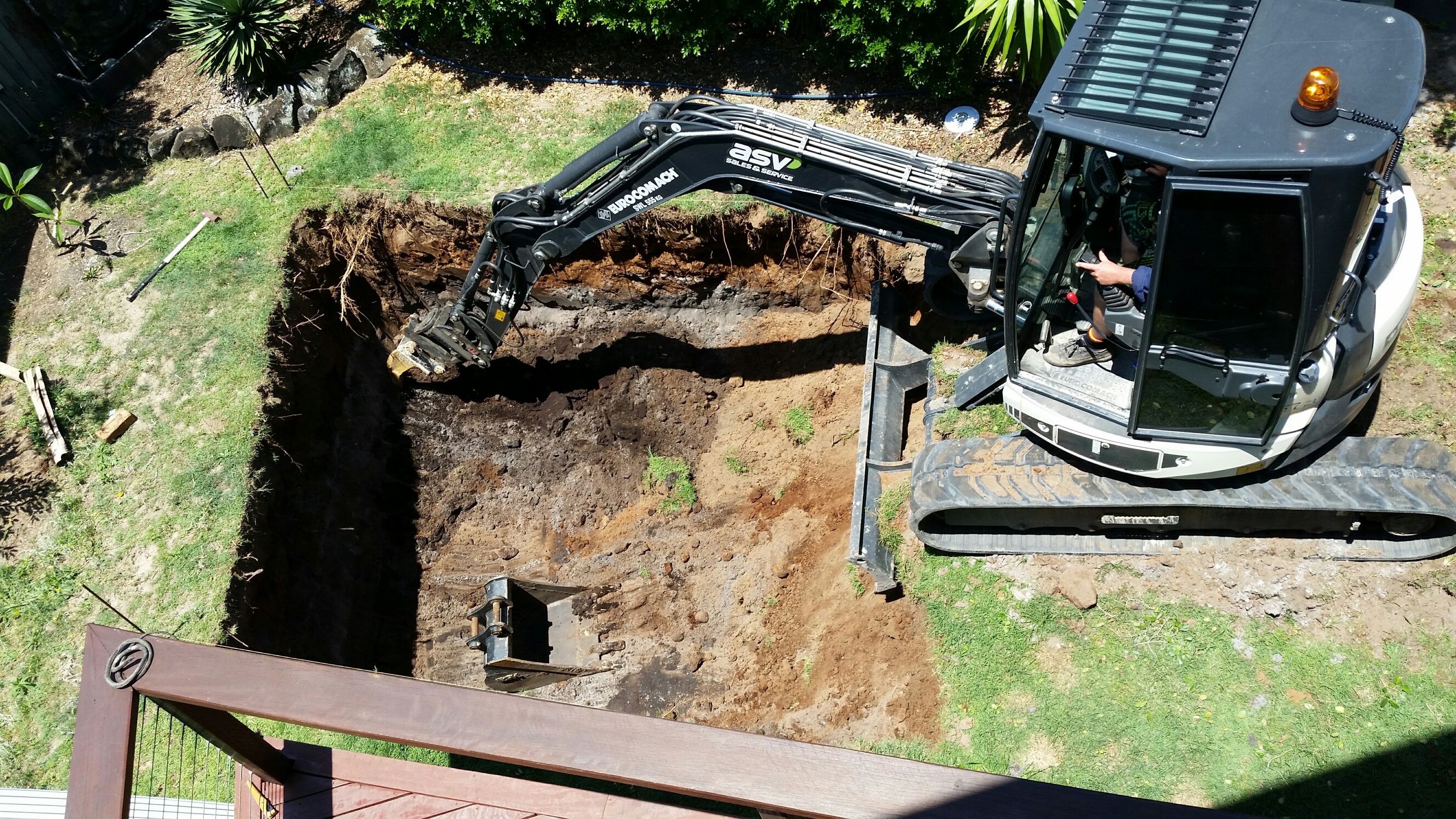 Excavator digging pool