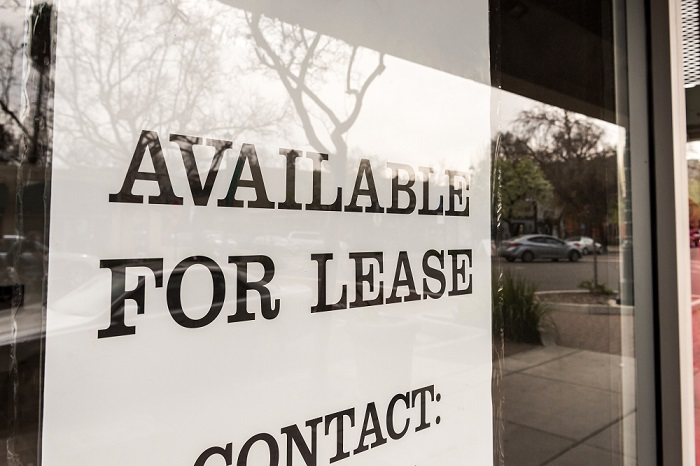 For Lease sign in commercial business window