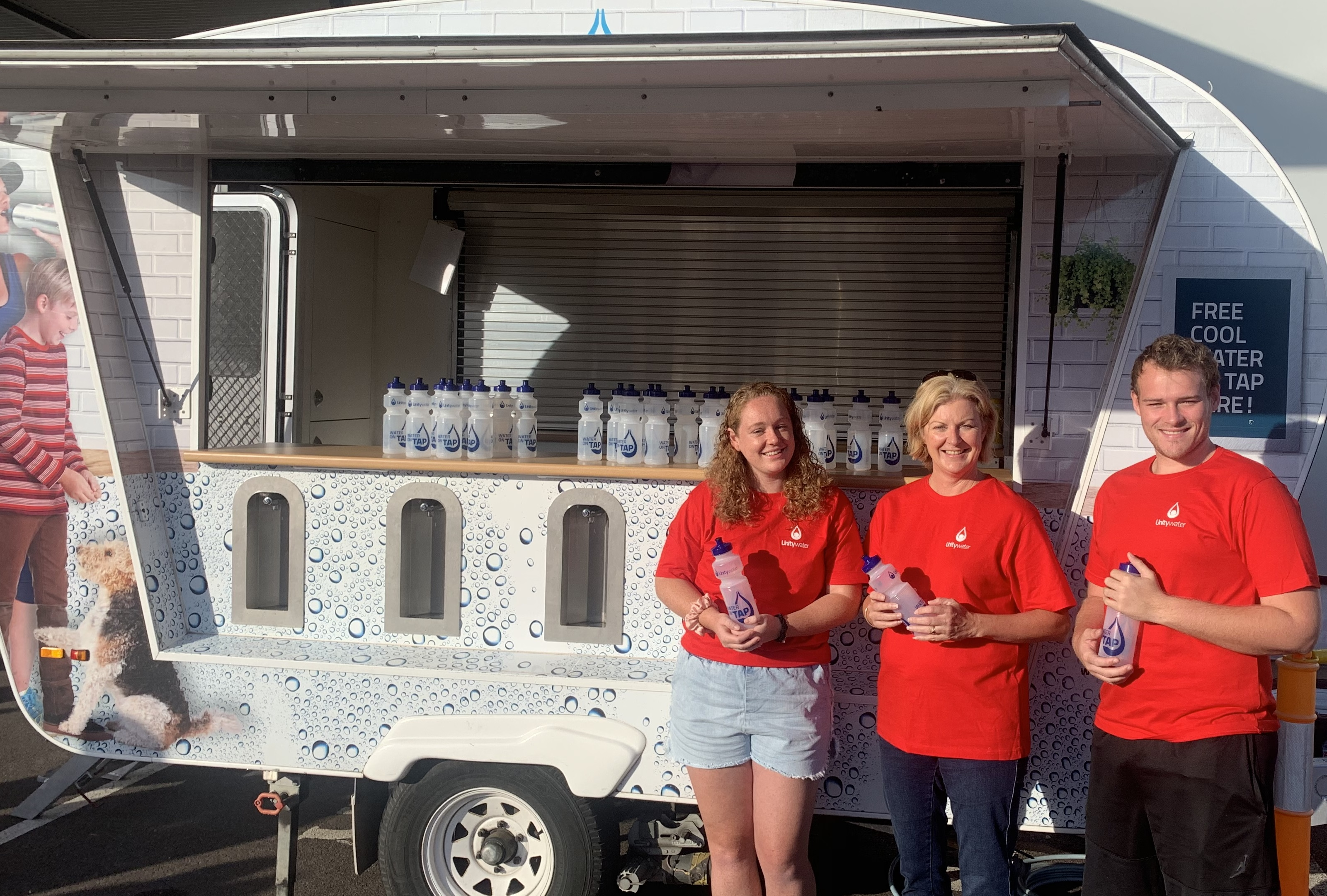 Water on tap van with volunteers