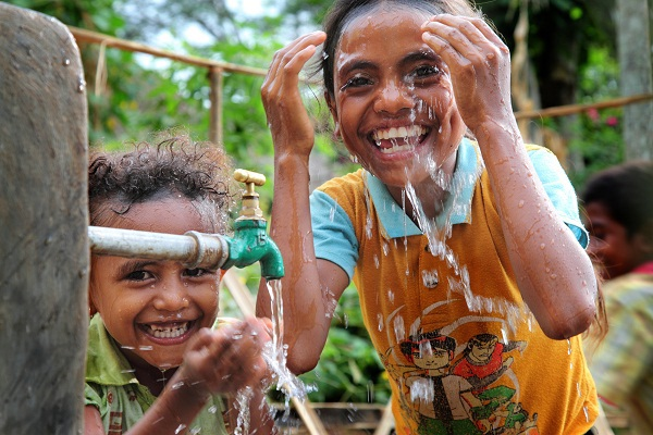Children at water tap in Timor