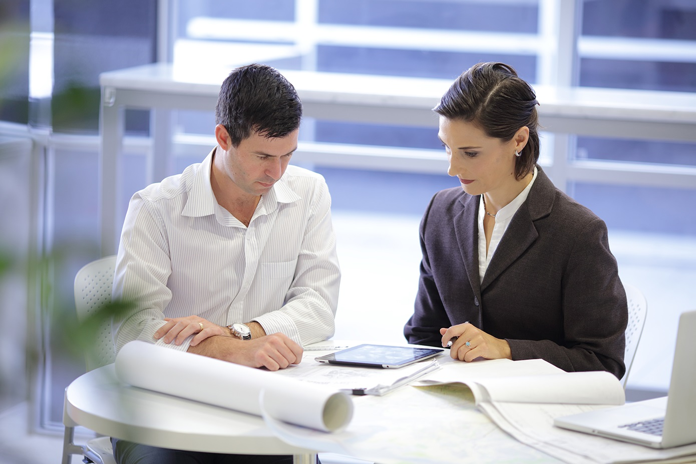Man and lady looking at papers appealing a decision
