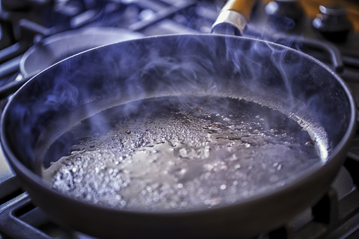 Oil cooking in pan