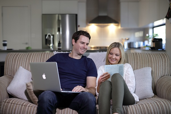 Couple on lounge, e-billing, residential, home