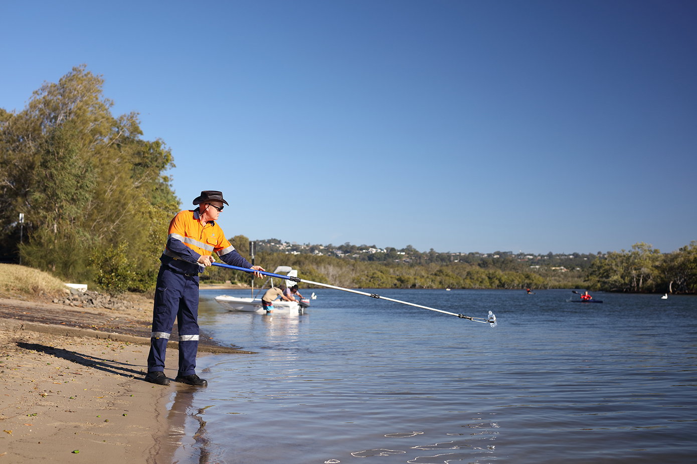Water tester taking water samples from Maroochy River