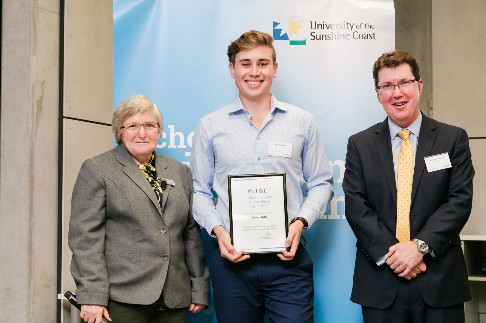 USC's Dr Helen Fairweather and Unitywater Executive Manager People Culture and Safety Kenan Hibberd present Isaac Huth with the 2018 Unitywater Scholarship in Engineering.