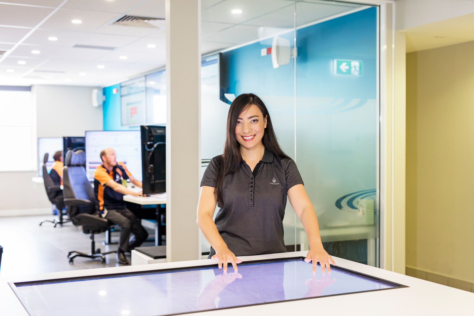 Unitywater female staff operating touch screen