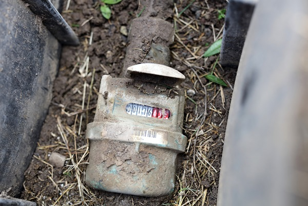 Water meter buried in dirt