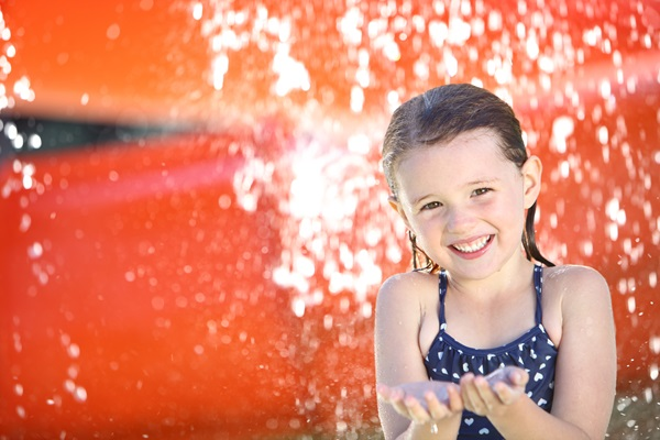 Girl playing in water park