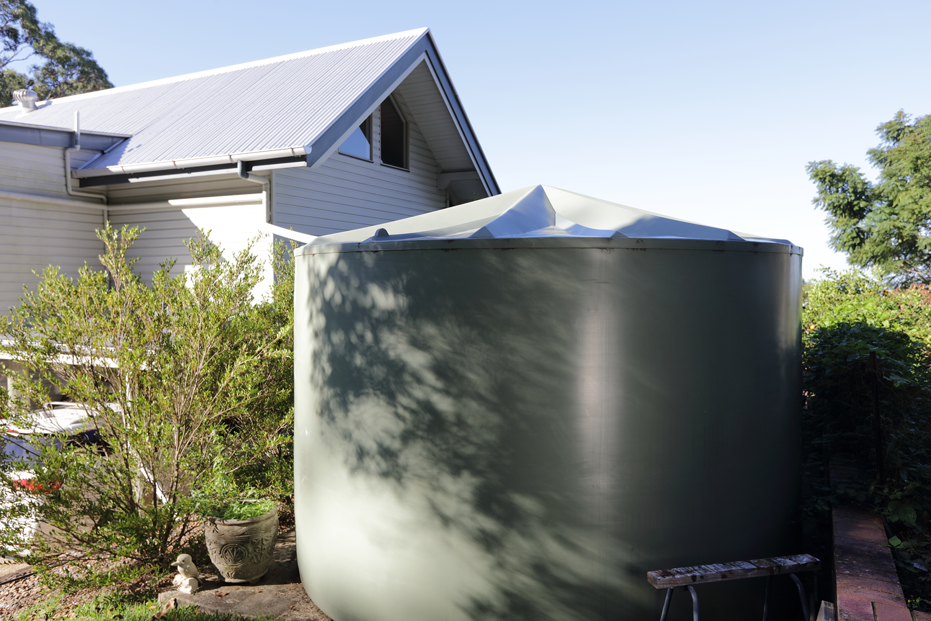 Water tank and house on residential property